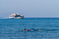 Ferry and boy in the sea Royalty Free Stock Photos