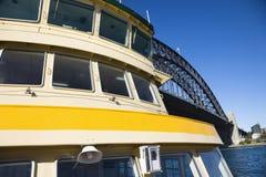 Ferry by bridge. Royalty Free Stock Photos