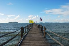 Ferry Bridge in the Sea with Flags Stock Photos