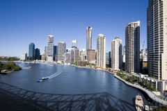 Ferry on brisbane river with skyline. In background royalty free stock photo