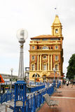 Ferry building in Auckland. Ferry building with blue fence in Auckland, New Zealand stock photos