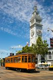 Orange Trolley Car The Embarcadero Downtown San Francisco California. The Ferry Building Clocktower stand in the San Francisco Skyline an Orenge Trolley Stock Images