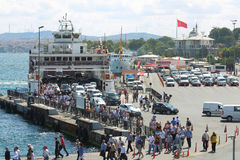 Ferry came to the pier and people Stock Photography
