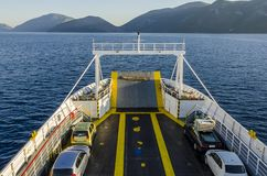 By ferry with the car to Pisaetos Ithaka. Prow of the ferry transporting cars by the Ionian sea from Sami Kefalonia towards Ithaka from which you can see the royalty free stock photo