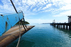 Ferry Carry car vehicles acroos Thai Bay to Koh Chang Island in. Head of Ferry carry car vehicle across island in tropical ocean and see vintage pier on right royalty free stock images