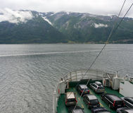 Ferry with cars on a fjord Royalty Free Stock Photos