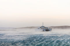 Ferry caught in heavy winds Royalty Free Stock Photo