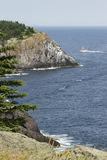 Ferry by the cliffs in Monhegan Island Stock Photos