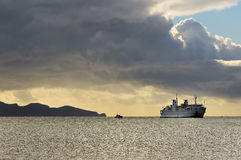 Ferry coming from island Stock Image