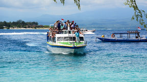 A ferry coming to the jetty in Bali island, Indonesia Stock Photography