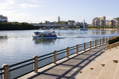A ferry commuting people to work in the city. Across brisbane river Stock Photos