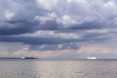 Ferry and container cargo ship on Baltic sea Stock Photo