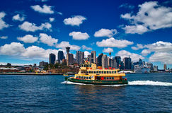 A ferry cross the harbour of Sydney. The skyline of Harbour became its background Royalty Free Stock Photos