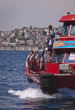 Ferry Crossing the Bosphorus. ISTANBUL, TURKEY – APRIL 27: Turkish people cross the Bosphorus on a transportation ferry prior to Anzac Day on April 27, 2012 in Royalty Free Stock Photos