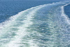 Ferry crossing the ocean royalty free stock photo