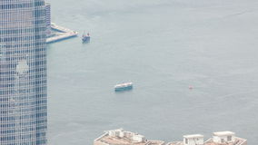 Ferry crossing the Victoria Harbour in Hong Kong stock video footage