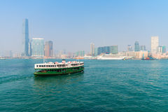 Ferry crossing the water in modern city Royalty Free Stock Photo
