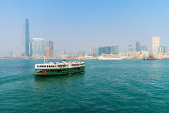 Ferry crossing the water in modern city Stock Photo