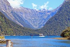 Ferry cruising in Milford sound Royalty Free Stock Photography