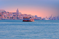 Ferry cruising on the river Tejo near Lisbon Portugal at sunset Stock Photos