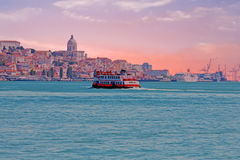 Ferry cruising on the river Tejo near Lisbon Portugal at sunset Royalty Free Stock Images
