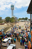 Ferry in Dar es Salaam. DAR ES SALAAM, TANZANIA - SEPTEMBER 20: A crowed of unidentified people and cars leave the Kivukoni/Kigamboni ferry on September 20, 2012 Royalty Free Stock Photography