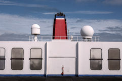 Ferry deck exterior with colorful chimney. Ferry exterior with red ship chimney and white deck wall Royalty Free Stock Photos