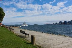 The ferry departing the Dartmouth side of the harbor heading towards downtown Halifax royalty free stock photo