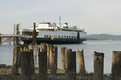 Ferry At The Dock. A ferry boat tied up to the dock in Anacortes royalty free stock images