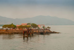 Ferry Dock in Costa Rica. Hazy view of a car ferry dock in early morning stock photo