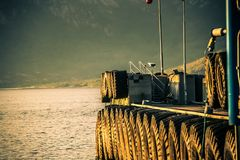Ferry dock with heavy tires and foaming water royalty free stock photography