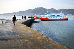 Ferry Docked. A ferry docked, taking on passengers in South Korea Royalty Free Stock Photo