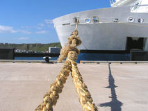Ferry Docked. A view up the rope to the ferry from the bollard it is secured to on its dock Royalty Free Stock Images