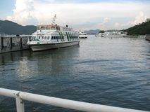 Ferries docked near the pier at Discovery bay, Lantau island, Hong Kong stock images