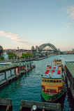 Ferry docked at pier and Sydney Harbour Bridge Stock Photo