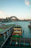 Ferry docked at pier and Sydney Harbour Bridge Stock Photography