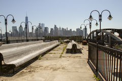 Ferry docks and New York City skyline Stock Images