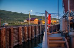 The ferry docks to the pier. Stock Image