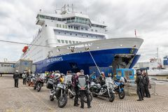 Ferry in Dutch harbor IJmuiden with motorcyclists waiting to embark. IJmuiden, The Netherlands - May 17, 2018: Ferry in Dutch harbor IJmuiden preparing to leave royalty free stock photos
