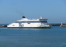 Ferry entering Dover, England. DOVER, ENGLAND, MAY 13 2015: View of the Port of Dover and a docking ferry. P&O is a British ferry company which operates ferrys Royalty Free Stock Images