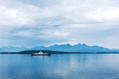 Ferry on the fjord in a overcast day Royalty Free Stock Image