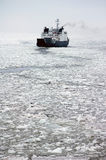 Ferry on frozen sea Royalty Free Stock Image