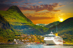 Ferry in Geiranger. Bay in the Norwegian mountains. Gold autumn Stock Photo