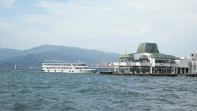 Ferry is going to ferry station of Konak stock video
