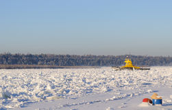 The ferry got stuck in hummocks on a frosty day in the middle of the wide Siberian river Stock Photo