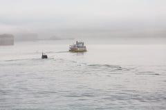 Ferry Heading Through Morning Fog Royalty Free Stock Photography