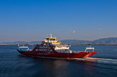 Ferry is heading to Limenas harbour at the island of Thassos Stock Photo