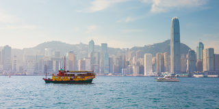 Ferry in Hong Kong with Victoria Harbour in background Royalty Free Stock Photo