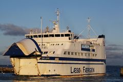 Ferry at Hou harbor in Denmark. Hou, Denmark - February 5, 2015: Ferry navigating between the harbor of Hou near Odder and Samsoe island royalty free stock photos