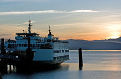 Ferry In Sunrise Stock Photo